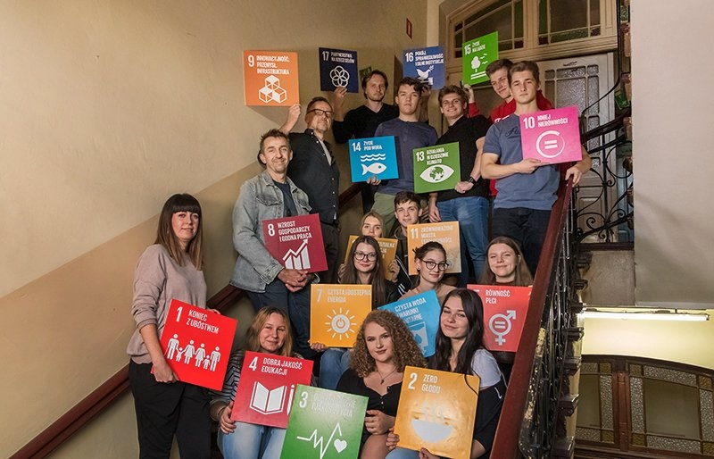 Young people holding UN SDG goal cards